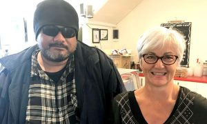 'Shadow', regular volunteer at Merge Café, and Julia West, Lifewise Merge Café Business Manager.