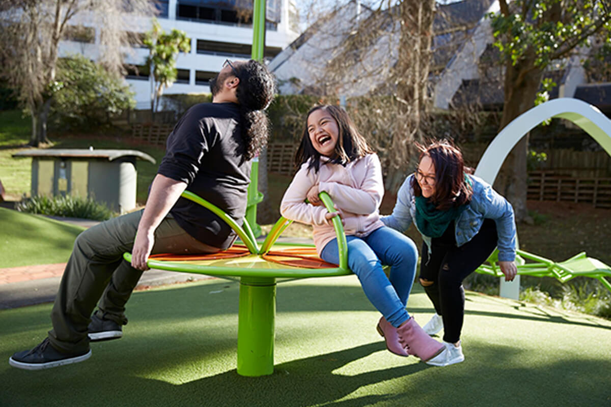 Family playing on a playground