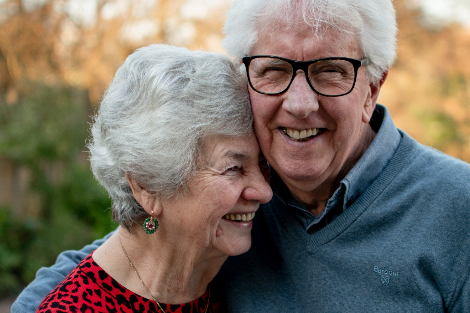 A happy elderly couple embracing